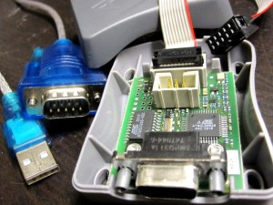 Atmel ISP programmer (with a nice surprise inside) and USB-to-Serial cable used to access the old device.